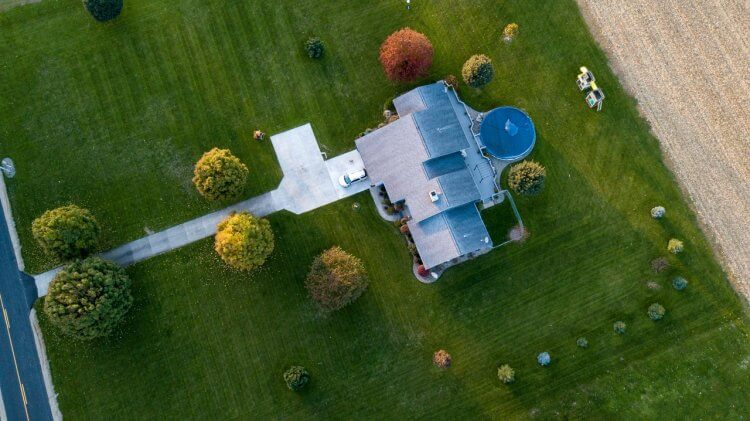 aerial photography of house 750x421 Landscape Design: Cost Factors